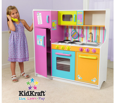 Kidkraft Deluxe Lets Cook Kitchen A Great Set Which Has Bold Primary Colors  It Includes Freezer Oven And Microwave Open And Close