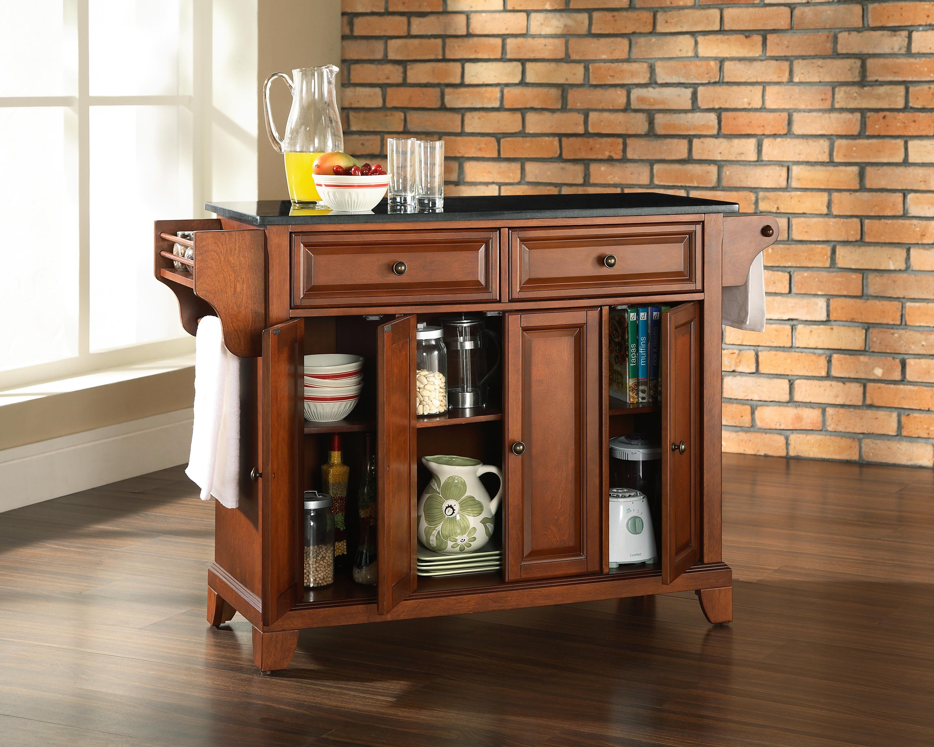 Solid black granite top kitchen island in classic cherry finish